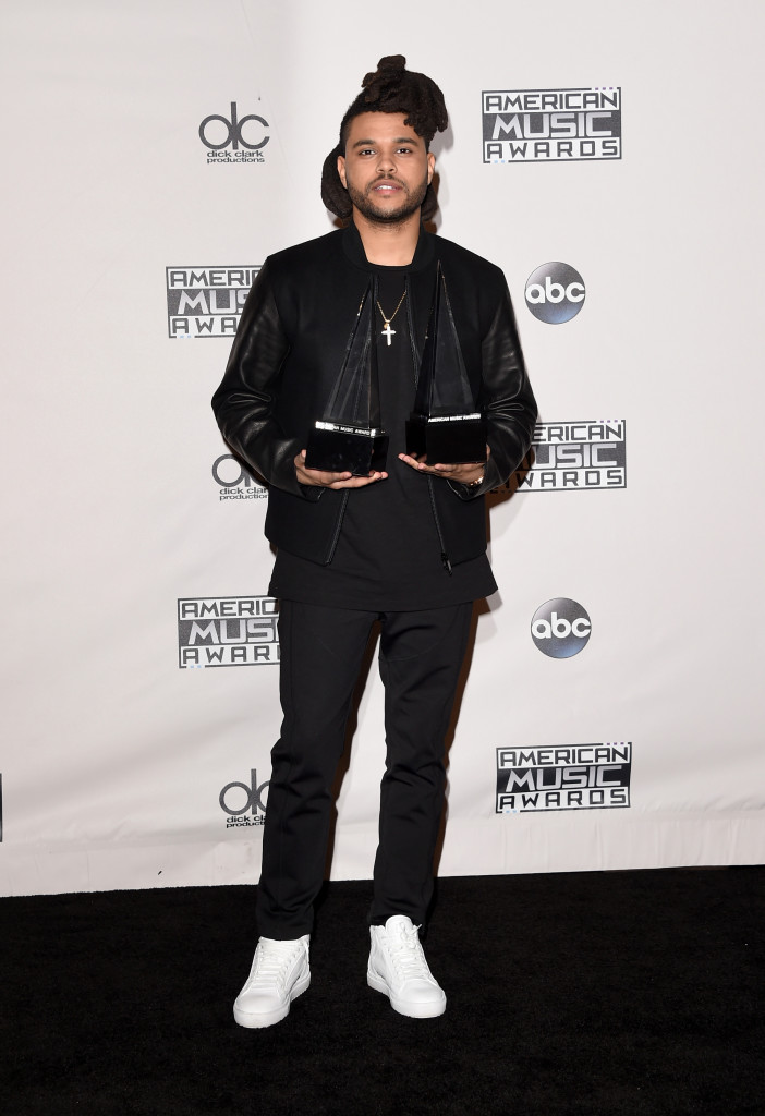 LOS ANGELES, CA - NOVEMBER 22: Recording artist The Weeknd, winner of Favorite Soul/R&B Male Artist and Favorite Soul/R&B Album, poses in the press room during the 2015 American Music Awards at Microsoft Theater on November 22, 2015 in Los Angeles, California. (Photo by Jason Merritt/Getty Images)