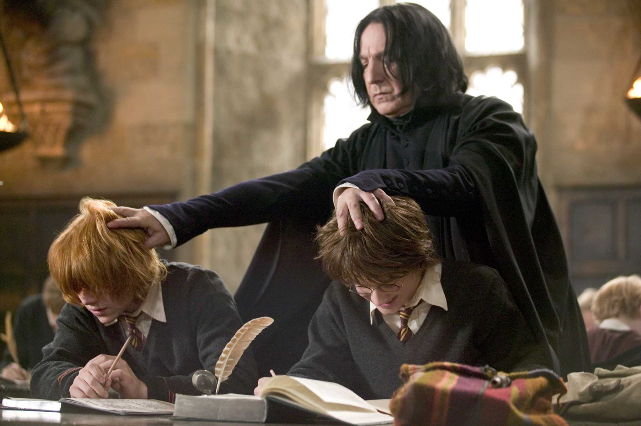 (L-r) RUPERT GRINT as Ron Weasley, ALAN RICKMAN as Severus Snape and DANIEL RADCLIFFE as Harry Potter in Warner Bros. PicturesÕ fantasy ÒHarry Potter and the Goblet of Fire.Ó PHOTOGRAPHS TO BE USED SOLELY FOR ADVERTISING, PROMOTION, PUBLICITY OR REVIEWS OF THIS SPECIFIC MOTION PICTURE AND TO REMAIN THE PROPERTY OF THE STUDIO. NOT FOR SALE OR REDISTRIBUTION.