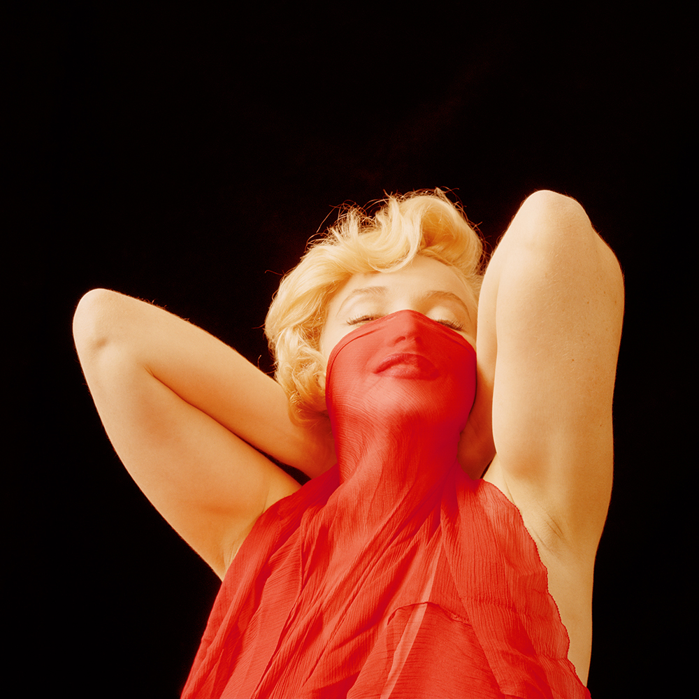 hbz-marilyn-playing-with-a-red-veil-ny-1957-milton-h-greene-archive-images