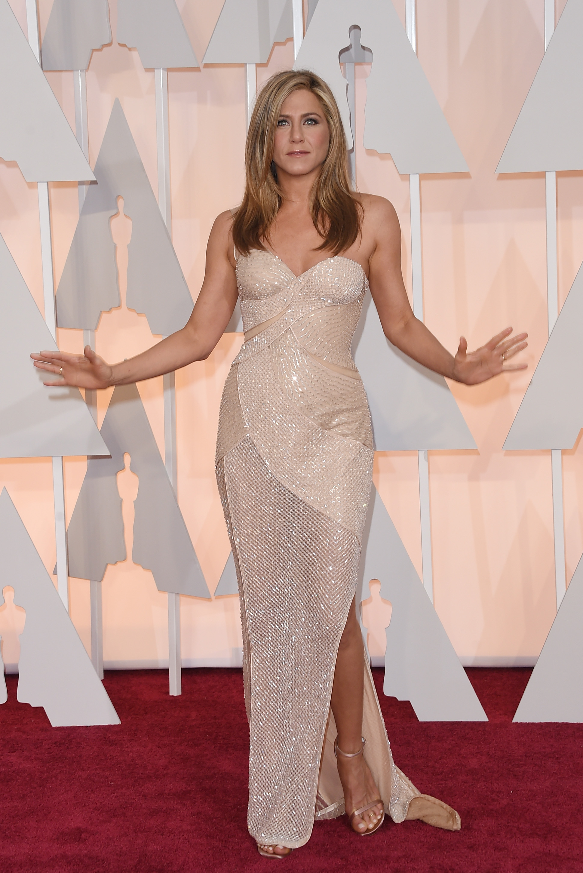HOLLYWOOD, CA - FEBRUARY 22: Actress Jennifer Aniston attends the 87th Annual Academy Awards at Hollywood & Highland Center on February 22, 2015 in Hollywood, California. (Photo by Jason Merritt/Getty Images)