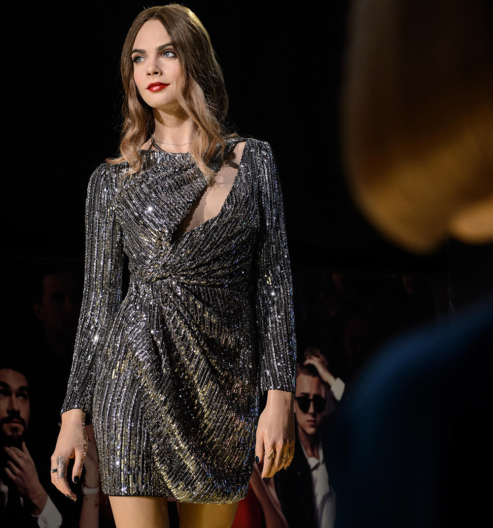 Anna Wintour looks on as Cara Delevingne struts down the catwalk at Fashion Week at Madame Tussauds London. Madame Tussauds London gave 100 fashionistas a special preview of its new 'behind-the-scenes' fashion experience this weekend, before opening t