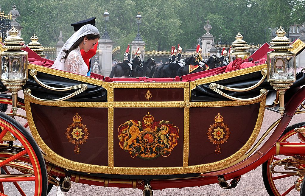 LONDON, ENGLAND - APRIL 29: TRH Prince William, Duke of Cambridge and Catherine, Duchess of Cambridge make the journey by carriage procession to Buckingham Palace following their marriage at Westminster Abbey on April 29, 2011 in London, England. The marriage of the second in line to the British throne was led by the Archbishop of Canterbury and was attended by 1900 guests, including foreign Royal family members and heads of state. Thousands of well-wishers from around the world have also flocked to London to witness the spectacle and pageantry of the Royal Wedding. (Photo by John Stillwell-WPA Pool/Getty Images)