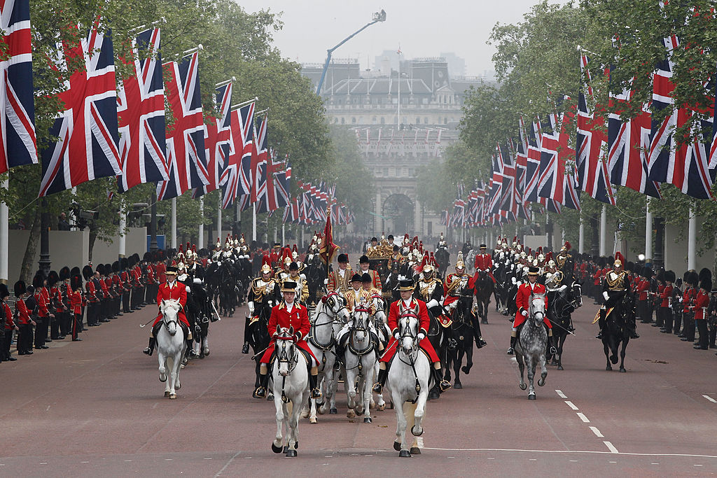 LONDON, ENGLAND - APRIL 29: A general view of the carriage procession to Buckingham Palace following the marriage of TRH Prince William, Duke of Cambridge and Catherine, Duchess of Cambridge at Westminster Abbey on April 29, 2011 in London, England. The marriage of the second in line to the British throne was led by the Archbishop of Canterbury and was attended by 1900 guests, including foreign Royal family members and heads of state. Thousands of well-wishers from around the world have also flocked to London to witness the spectacle and pageantry of the Royal Wedding. (Photo by Christopher Furlong/Getty Images)