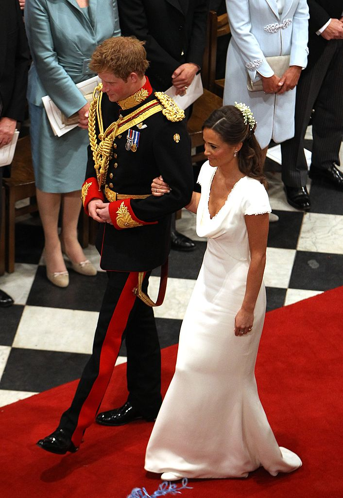 LONDON, UNITED KINGDOM - APRIL 29: Prince Harry and Maid of Honour Pippa Middleton walk down the aisle at Westminster Abbey following the wedding ceremony of Prince William, Duke of Cambridge and Catherine, Duchess of Cambridge on April 29, 2011 in London England. The marriage of the second in line to the British throne was led by the Archbishop of Canterbury and was attended by 1900 guests, including foreign Royal family members and heads of state. Thousands of well-wishers from around the world have also flocked to London to witness the spectacle and pageantry of the Royal Wedding. (Photo by Clara Molden - WPA Pool/Getty Images)