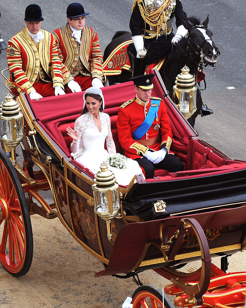 LONDON, ENGLAND - APRIL 29: In this handout image provided by Crown Copyright, Their Royal Highnesses Prince William, Duke of Cambridge and Catherine, Duchess of Cambridge journey by carriage procession to Buckingham Palace following their marriage at Westminster Abbey on April 29, 2011 in London, England. The marriage of the second in line to the British throne was led by the Archbishop of Canterbury and was attended by 1900 guests, including foreign Royal family members and heads of state. Thousands of well-wishers from around the world have also flocked to London to witness the spectacle and pageantry of the Royal Wedding. (POA(Phot) Mez Merrill/Mandatory Credit MOD/Crown Copyright via Getty Images)