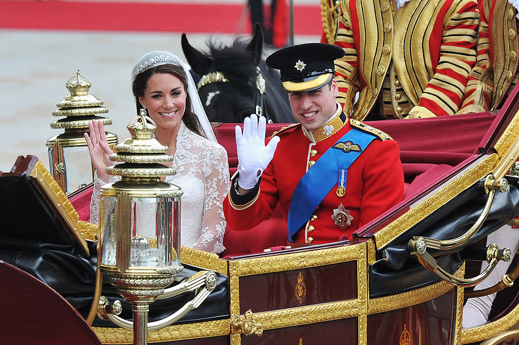 LONDON, ENGLAND - APRIL 29: Their Royal Highnesses Prince William, Duke of Cambridge and Catherine, Duchess of Cambridge journey by carriage procession to Buckingham Palace following their marriage at Westminster Abbey on April 29, 2011 in London, England. The marriage of the second in line to the British throne was led by the Archbishop of Canterbury and was attended by 1900 guests, including foreign Royal family members and heads of state. Thousands of well-wishers from around the world have also flocked to London to witness the spectacle and pageantry of the Royal Wedding. (Photo by Pascal Le Segretain/Getty Images)