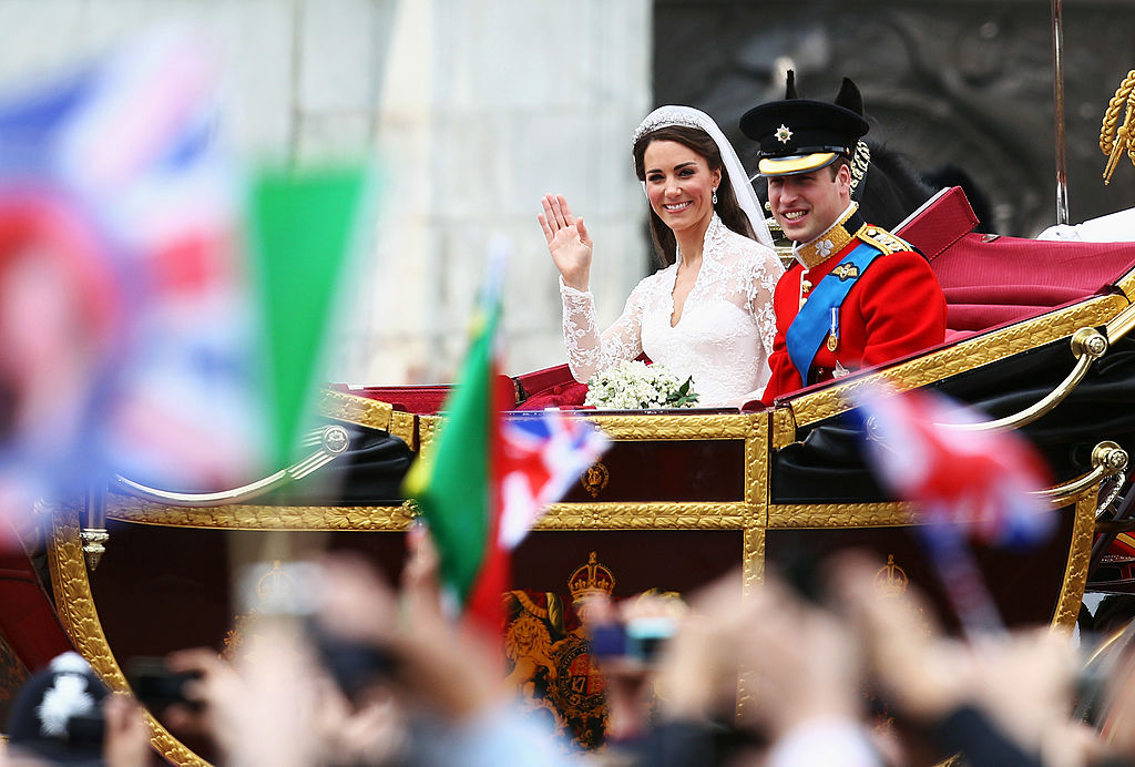 LONDON, ENGLAND - APRIL 29: Their Royal Highnesses Prince William, Duke of Cambridge and Catherine, Duchess of Cambridge journey by carriage procession to Buckingham Palace following their marriage at Westminster Abbey on April 29, 2011 in London, England. The marriage of the second in line to the British throne is to be led by the Archbishop of Canterbury and will be attended by 1900 guests, including foreign Royal family members and heads of state. Thousands of well-wishers from around the world have also flocked to London to witness the spectacle and pageantry of the Royal Wedding. (Photo by Paul Gilham/Getty Images)
