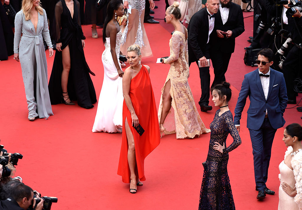 """CANNES, FRANCE - MAY 16: Kate Moss and Xiao Wen Ju attend the """"Loving"""" premiere during the 69th annual Cannes Film Festival at the Palais des Festivals on May 16, 2016 in Cannes, France. (Photo by Clemens Bilan/Getty Images)"""