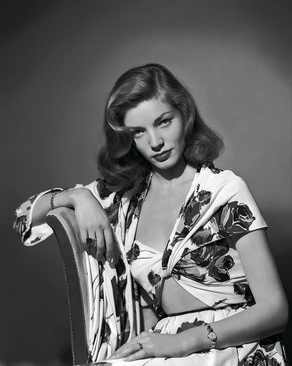 circa 1945: American screen star Lauren Bacall wearing a summer suit in a bold floral print Restricted to editorial use related to the film or the individuals involved (producers, directors, authors, actors, etc.)