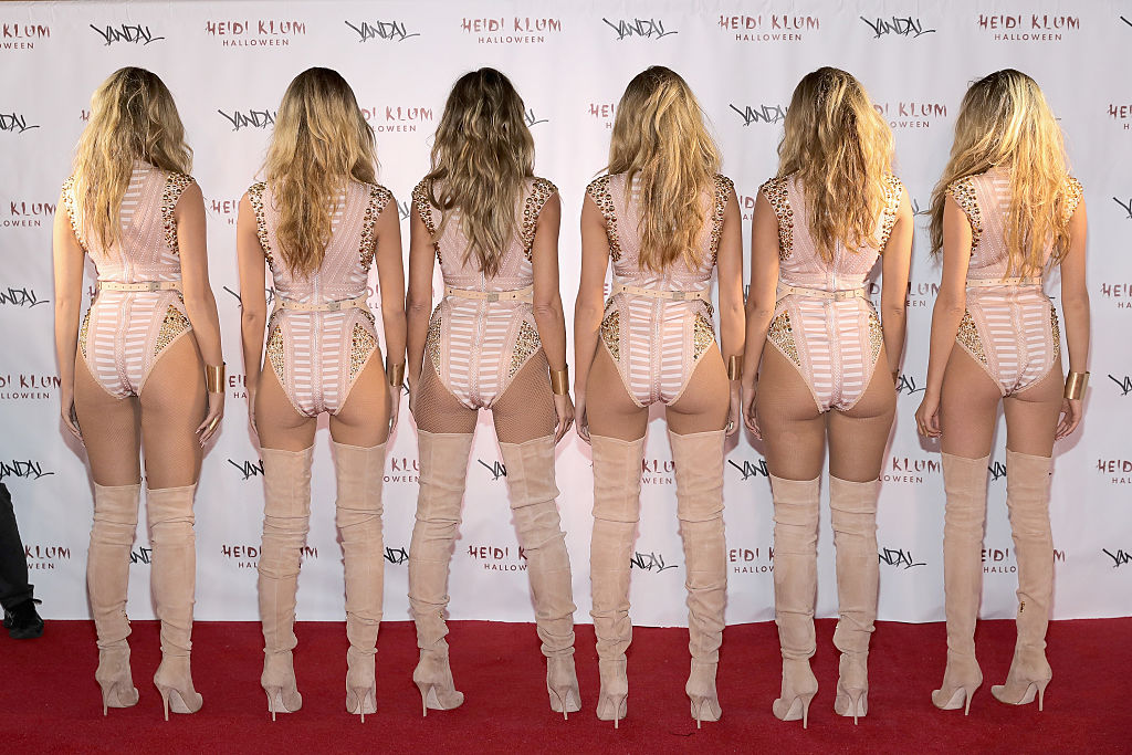NEW YORK, NY - OCTOBER 31: Model Heidi Klum (3rd L) reveals her costume during Heidi Klum's 17th Annual Halloween Party sponsored by SVEDKA Vodka at Vandal on October 31, 2016 in New York City. (Photo by Neilson Barnard/Getty Images for Heidi Klum)